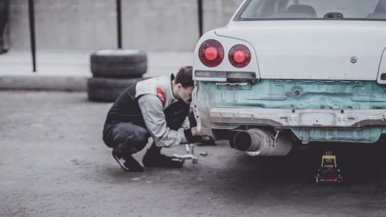 guy working on his car